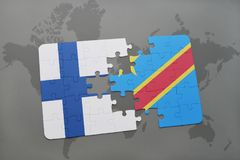 Puzzle with the national flag of finland and democratic republic of the congo on a world map background. 3D illustration Royalty Free Stock Photo