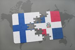 Puzzle with the national flag of finland and dominican republic on a world map background. Stock Photos