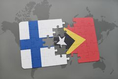 Puzzle with the national flag of finland and east timor on a world map background. Stock Photography