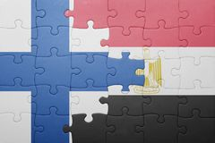 Puzzle with the national flag of finland and egypt Stock Image