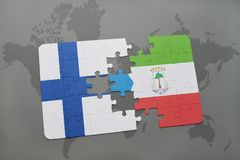 Puzzle with the national flag of finland and equatorial guinea on a world map background. 3D illustration Stock Photo