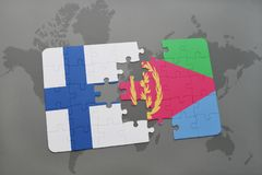 Puzzle with the national flag of finland and eritrea on a world map background. 3D illustration Stock Photo