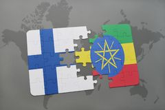 Puzzle with the national flag of finland and ethiopia on a world map background. 3D illustration Royalty Free Stock Images
