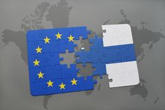 Puzzle with the national flag of finland and european union on a world map background. Royalty Free Stock Image