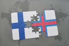 Puzzle with the national flag of finland and faroe islands on a world map background. 3D illustration stock photo