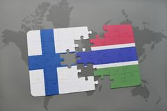 Puzzle with the national flag of finland and gambia on a world map background. 3D illustration Royalty Free Stock Photos