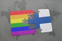 Puzzle with the national flag of finland and gay rainbow flag on a world map background. 3D illustration Stock Image