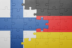 Puzzle with the national flag of finland and germany Royalty Free Stock Photos
