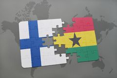 Puzzle with the national flag of finland and ghana on a world map background. 3D illustration Royalty Free Stock Photography