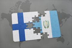 Puzzle with the national flag of finland and guatemala on a world map background. Stock Photo