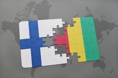 Puzzle with the national flag of finland and guinea on a world map background. 3D illustration Stock Image