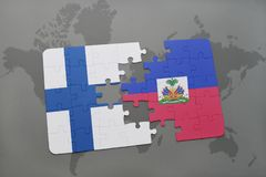 Puzzle with the national flag of finland and haiti on a world map background. Royalty Free Stock Image