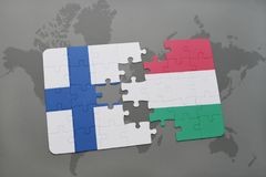 Puzzle with the national flag of finland and hungary on a world map background. 3D illustration Royalty Free Stock Image