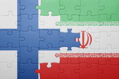 Puzzle with the national flag of finland and iran Royalty Free Stock Image