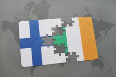 Puzzle with the national flag of finland and ireland on a world map background. 3D illustration Royalty Free Stock Image