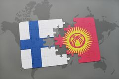 Puzzle with the national flag of finland and kyrgyzstan on a world map background. 3D illustration Royalty Free Stock Photography