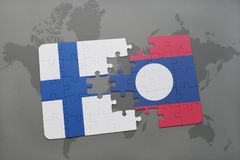 Puzzle with the national flag of finland and laos on a world map background. 3D illustration Stock Photo