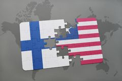 Puzzle with the national flag of finland and liberia on a world map background. 3D illustration Royalty Free Stock Photos