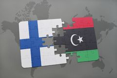 Puzzle with the national flag of finland and libya on a world map background. 3D illustration Royalty Free Stock Image