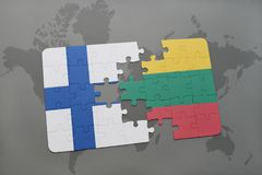 Puzzle with the national flag of finland and lithuania on a world map background. 3D illustration Royalty Free Stock Image