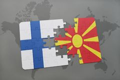 Puzzle with the national flag of finland and macedonia on a world map background. Royalty Free Stock Photo
