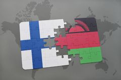 Puzzle with the national flag of finland and malawi on a world map background. 3D illustration Stock Photography