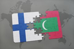 Puzzle with the national flag of finland and maldives on a world map background. 3D illustration Royalty Free Stock Image