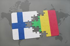 Puzzle with the national flag of finland and mali on a world map background. 3D illustration Royalty Free Stock Photo