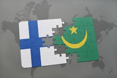 Puzzle with the national flag of finland and mauritania on a world map background. 3D illustration Stock Photos