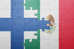 Puzzle with the national flag of finland and mexico Stock Photo