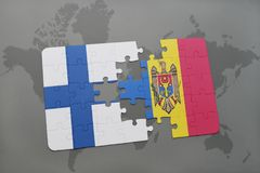 Puzzle with the national flag of finland and moldova on a world map background. Stock Photos