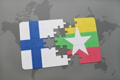Puzzle with the national flag of finland and myanmar on a world map background. 3D illustration Stock Photo