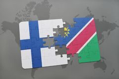 Puzzle with the national flag of finland and namibia on a world map background. 3D illustration Royalty Free Stock Images