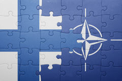 Puzzle with the national flag of finland and nato Stock Photography