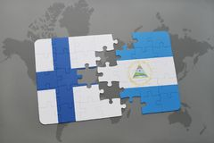 Puzzle with the national flag of finland and nicaragua on a world map background. Royalty Free Stock Image