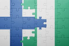 Puzzle with the national flag of finland and nigeria Royalty Free Stock Images