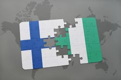 Puzzle with the national flag of finland and nigeria on a world map background. 3D illustration Stock Photo
