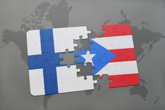 Puzzle with the national flag of finland and puerto rico on a world map background. Royalty Free Stock Photos