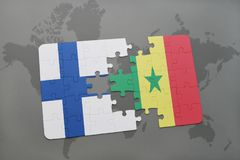 Puzzle with the national flag of finland and senegal on a world map background. Stock Image
