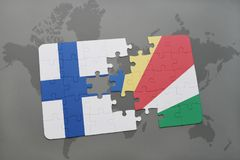 Puzzle with the national flag of finland and seychelles on a world map background. 3D illustration Royalty Free Stock Photography