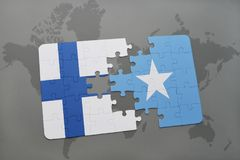 Puzzle with the national flag of finland and somalia on a world map background. 3D illustration Stock Images