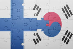 Puzzle with the national flag of finland and south korea. Concept royalty free stock image