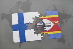 Puzzle with the national flag of finland and swaziland on a world map background. 3D illustration Royalty Free Stock Image