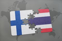 Puzzle with the national flag of finland and thailand on a world map background. 3D illustration Royalty Free Stock Photography
