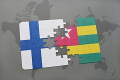 Puzzle with the national flag of finland and togo on a world map background. 3D illustration Stock Photo