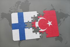 Puzzle with the national flag of finland and turkey on a world map background. 3D illustration Stock Photo