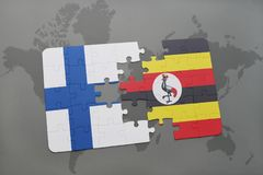 Puzzle with the national flag of finland and uganda on a world map background. 3D illustration Royalty Free Stock Image