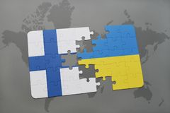 Puzzle with the national flag of finland and ukraine on a world map background. 3D illustration Royalty Free Stock Photo