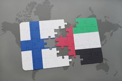 Puzzle with the national flag of finland and united arab emirates on a world map background. 3D illustration Stock Images