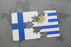 Puzzle with the national flag of finland and uruguay on a world map background. Royalty Free Stock Image